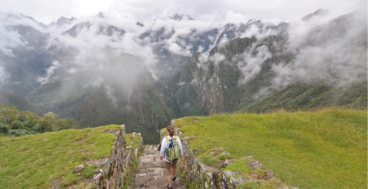 machu picchu site surrounded by cloud covered mountains