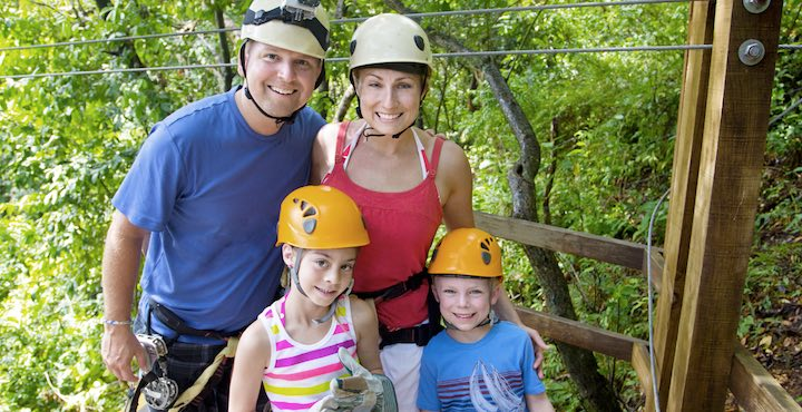 a family zip lining in costa rica