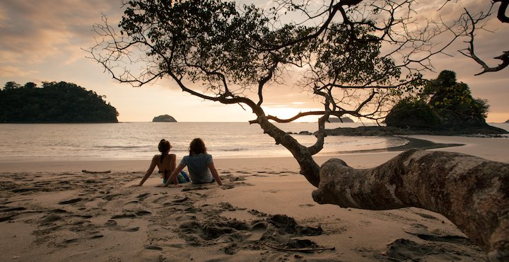 couple on manuel antonio beach costa rica