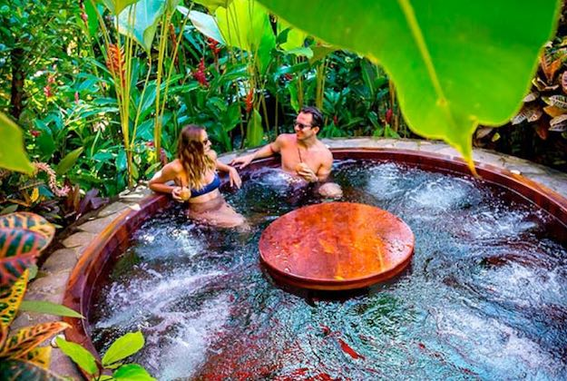 nayara hotel and gardens arenal couple in jacuzzi
