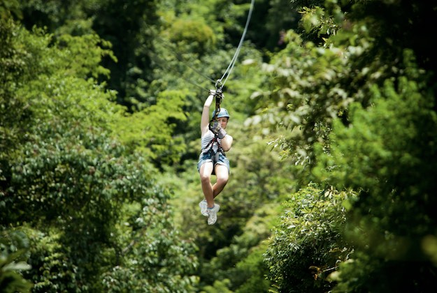 girl on a zip lining tour in arenal costa rica
