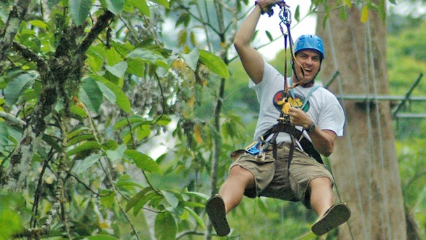 man zip lining in costa rica