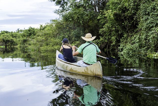 a couple canoeing in the amazon ecuador