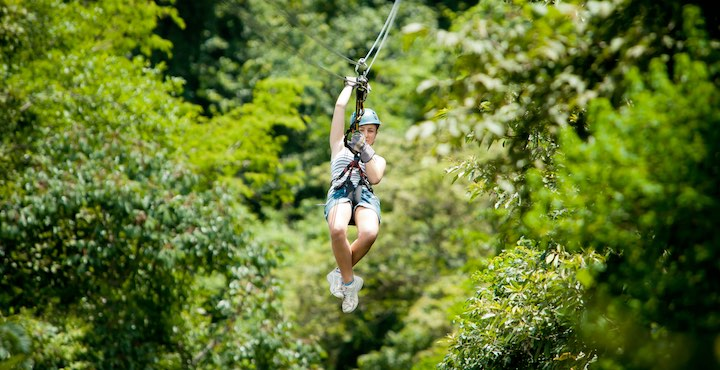 girl zip lining in arenal costa rica