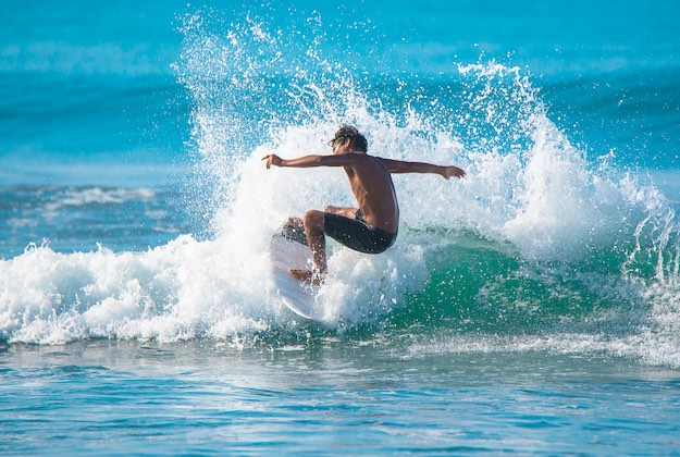 surfing on the pacific coast of costa rica