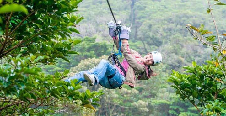 woman zip lining at sky trek monteverde